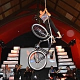 An aerialist performed her magic on a hanging bike.