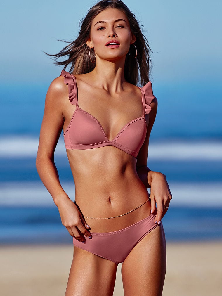 Be girlie about your look and shop Victoria's Secret Pink's Ruffle Strap Bikini Top ($37), which has supportive cups and eye-catching flutter straps.