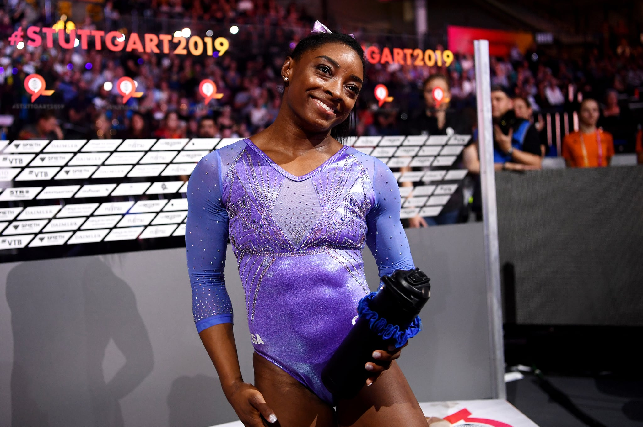STUTTGART, GERMANY - OCTOBER 13: Simone Biles of The United States celebrates winning gold in Women's Floor Final during day 10 of the 49th FIG Artistic Gymnastics World Championships at Hanns-Martin-Schleyer-Halle on October 13, 2019 in Stuttgart, Germany. (Photo by Laurence Griffiths/Getty Images)