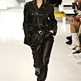 Walking in Tod's wearing a leather look.