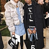 Pharrell Williams and his wife, Helen Lasichanh, went for denim and bold outerwear.