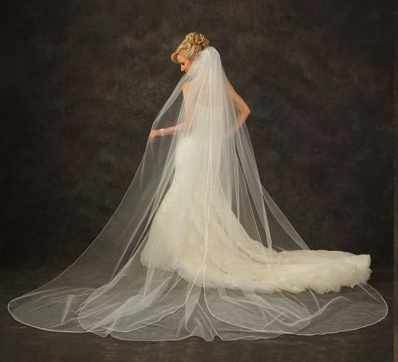 This JI Johnson veil comes from the site Recycled Bride where you can buy and sell literally everything from your wedding. Instead of buying something completely new, just reuse something worn once.