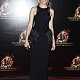 Elizabeth Banks showed off a fringe-trimmed and embellished black Alexander McQueen gown from the brand's Spring 2013 collection on the Catching Fire red carpet in Paris.