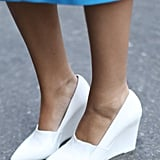 Stark white pumps were quite the contrast against this sky-blue skirt.