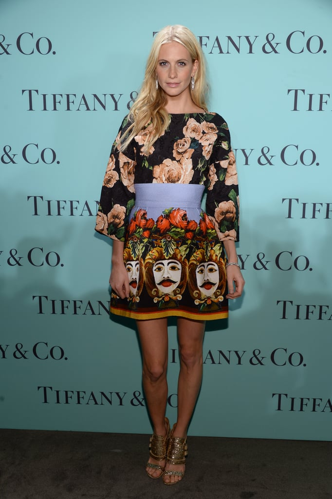 Poppy Delevingne opted for a fun printed look by Dolce & Gabbana paired with shimmery gold Givenchy sandals.