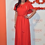Paula Patton went with a statement red waist-tie maxi dress at the Coach benefit.