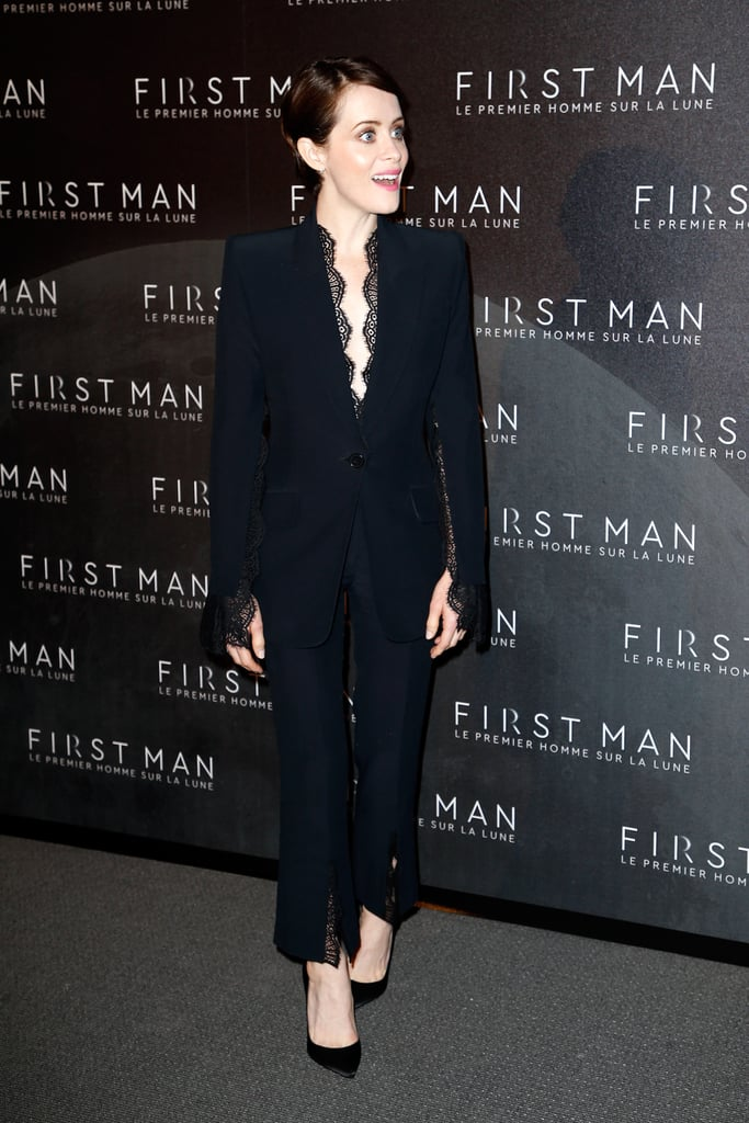 When in France, Claire looked incredibly chic in a black pantsuit that featured delicate lace detailing.
