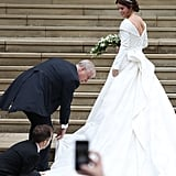 Andrew helped Eugenie with her gown while arriving at her wedding in Oct. 2018.