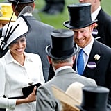 Meghan and Harry were all smiles while chatting with Prince Charles at the Royal Ascot in June 2018.