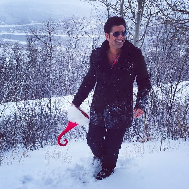 John Stamos took some time to play in the snow.