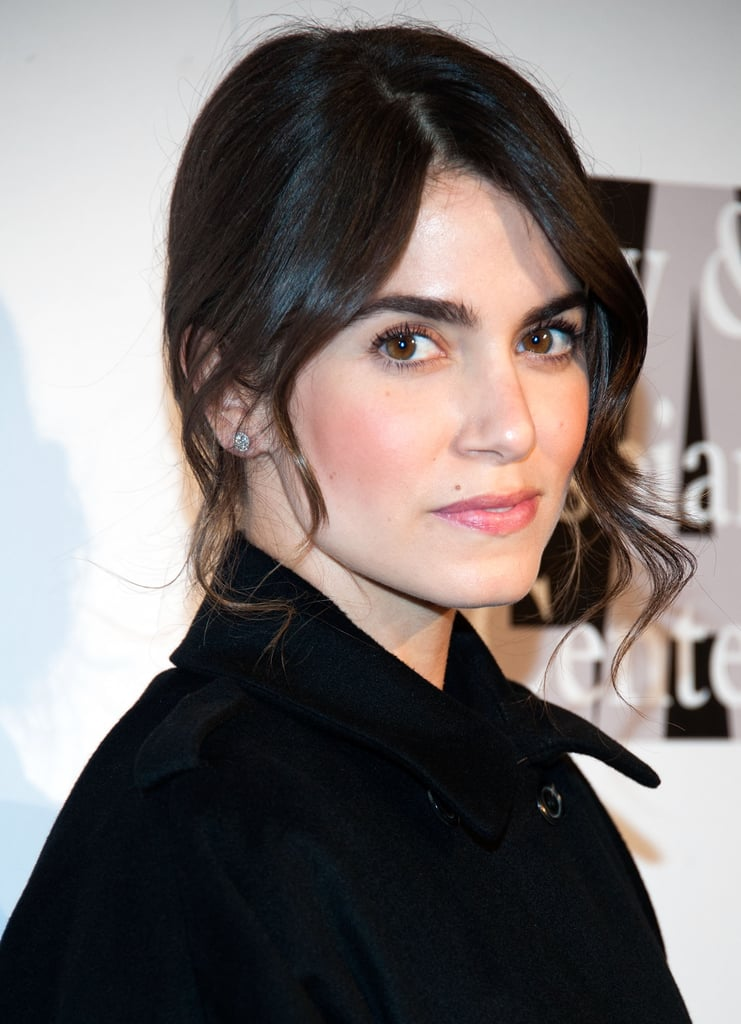 With her hair pulled back into a casual updo, Nikki Reed's ombré ends were out of sight. A pink flush on the cheeks and lips, along with bold brows (achieved by using European Wax Center's Brow Powder in Venice), completed her sophisticated style.