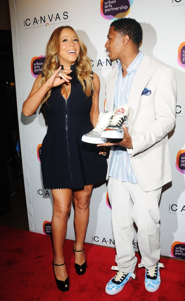 """Mariah Carey and her husband Nick Cannon hit the town in NYC last night to attend the 2012 Project Canvas Exhibition and Art Gala. The event was held at the city's Opera Gallery and was designed to raise money for art programs in NYC schools. Mariah was on hand to support Nick, who hosted. She tweeted, """"At Nick's launch for project canvas. The shoes. . . Come on. . . A winner!"""" It was Nick and Mariah's latest special night. They were just in Paris to renew their vows in honor of their fourth wedding anniversary. Their children went along for the European excursion as well. Moroccan and Monroe Cannon's first birthday was on April 30, as Mariah welcomed them last year on her and Nick's third anniversary."""