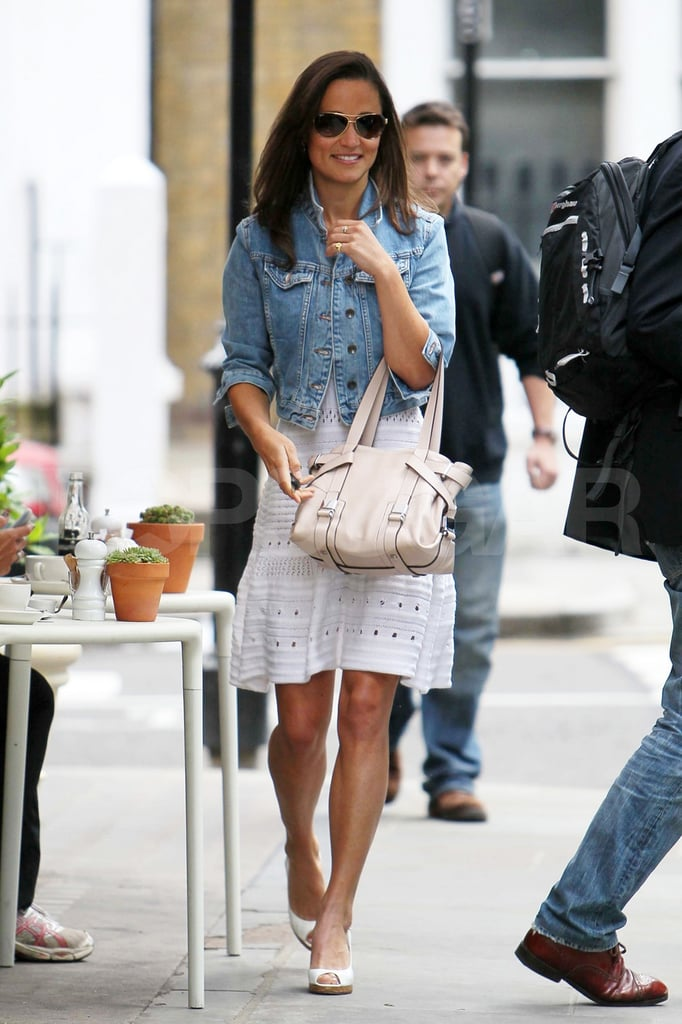 Pippa Middleton covered up her trendy Summer eyelet dress with a denim jacket in London today. She headed out to watch Andy Roddick beat South Africa's Kevin Anderson in the AEGON Tennis Championships. Pippa seems to love sitting court side, as she was also in Paris last month for the French Open. Pippa's been in the spotlight since her sister's gorgeous wedding to Prince William in April, and she returned to the Goring Hotel, where she and Kate stayed before the big day, for a party with her parents Carole and Michael on Tuesday. Kate didn't join her family at the event, since she's been busy prepping for another public appearance with her husband. The annual Ark dinner is this evening, and Kate Middleton went to the Lock & Co. hat makers in a fuchsia dress this morning as she ran some last-minute errands.