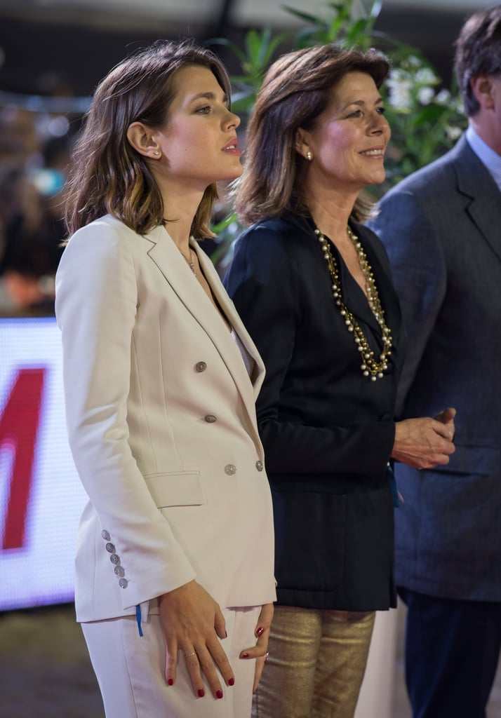Charlotte stood with her mother, Princess Caroline, at an official event in late June 2013, when pregnancy rumours heated up.