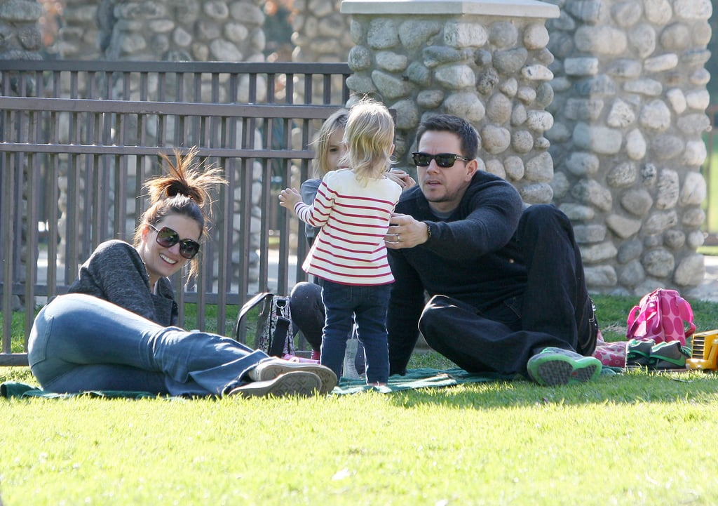Mark Wahlberg and Rhea Durham with their kids at a park.