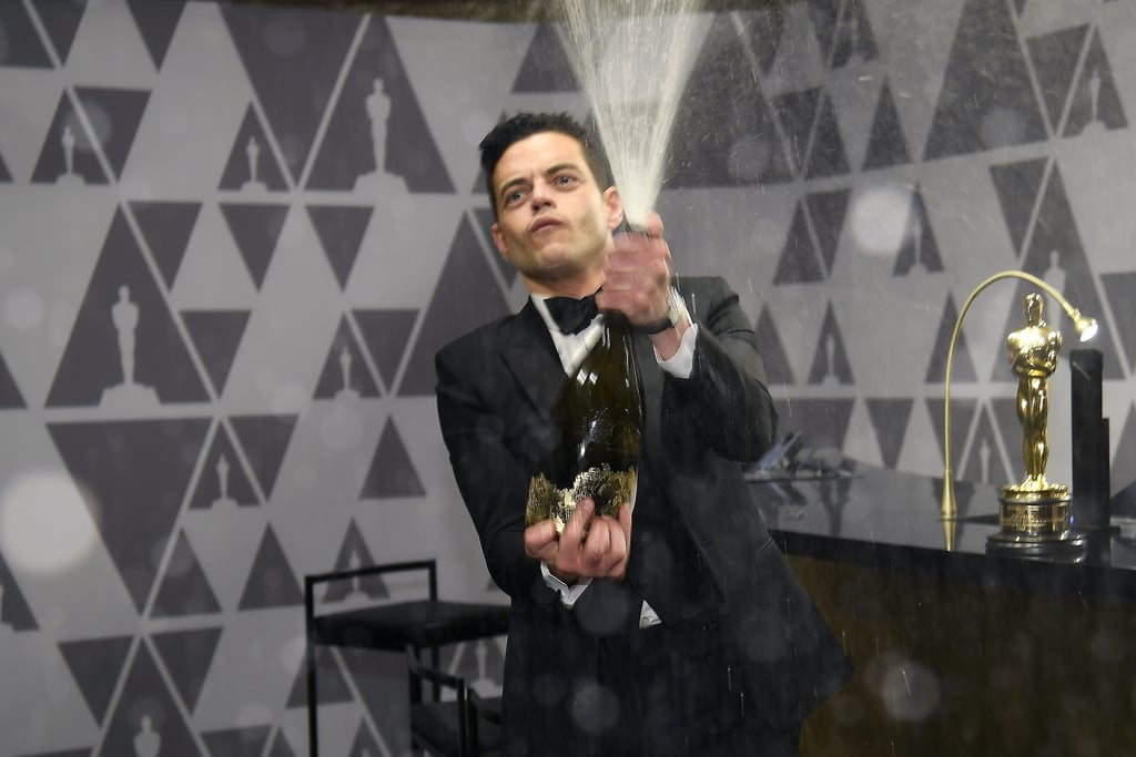 I Hope Rami Malek Didn't Ruin Any Outfits With His Wild Champagne Spray at the Oscars