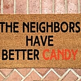 The Neighbors Have Better Candy Welcome Mat ($28)