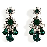 The mix of white and emerald crystals in these Shourouk Emerald Green Crystal Earrings ($440) make for a fun, elegant addition to your party look.