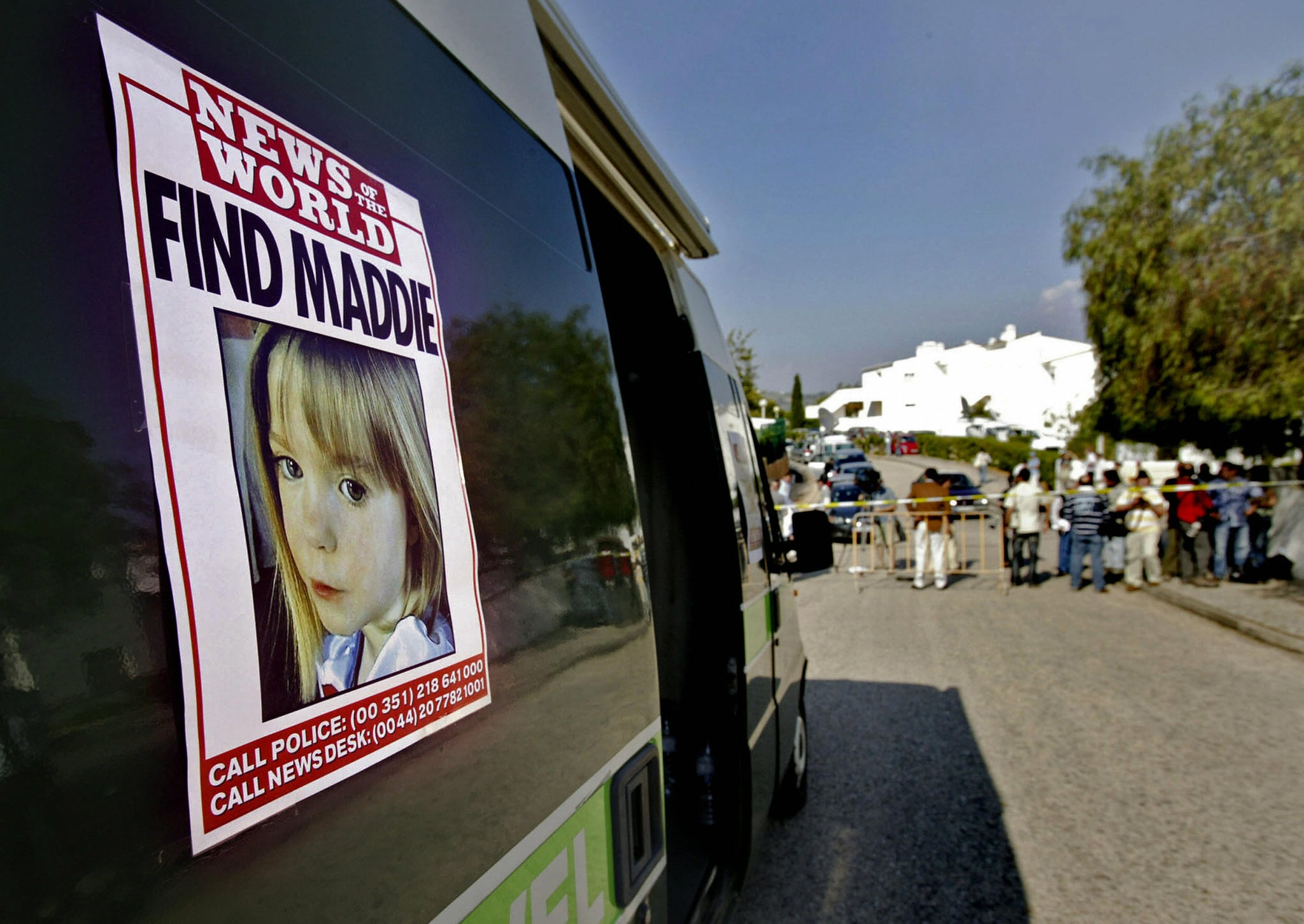 Lagos, PORTUGAL: A poster placed on a van shows the picture of three-year old British girl Madelaine McCann outside the Ocean club apartment hotel in Praia de Luz 05 May 2007, in Lagos. A team of three British police detectives arrived in Portugal today to help track down a suspected kidnapper believed to have abducted the British toddler.  AFP PHOTO/ Vasco CELIO (Photo credit should read VASCO CELIO/AFP/Getty Images)