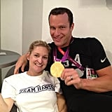 Brendan Hansen flashed a smile and his brand new gold medal while posing for a photo with his wife, Martha. Source: Twitter user eswright