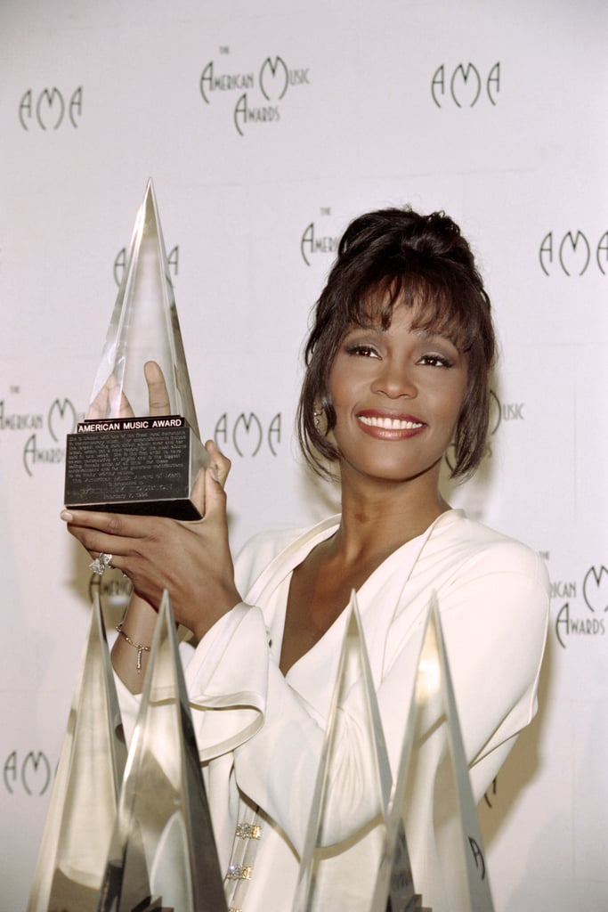 She held up an American Music Award in 1994.