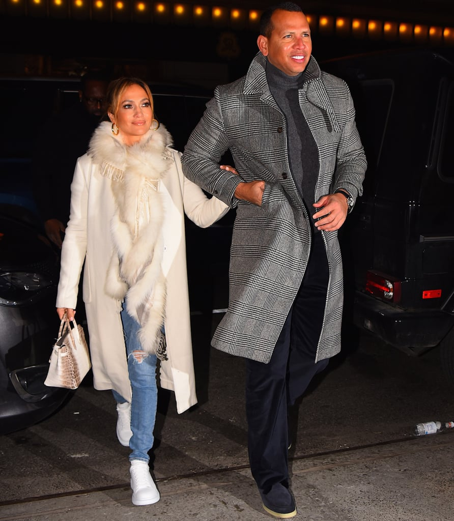 e9521d515911 Jennifer Lopez's White Coat and Sneakers With Alex Rodriguez ...