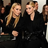 Mary-Kate Olsen and Ashley Olsen sitting front row at NY Fashion Week.  worldredeye.com