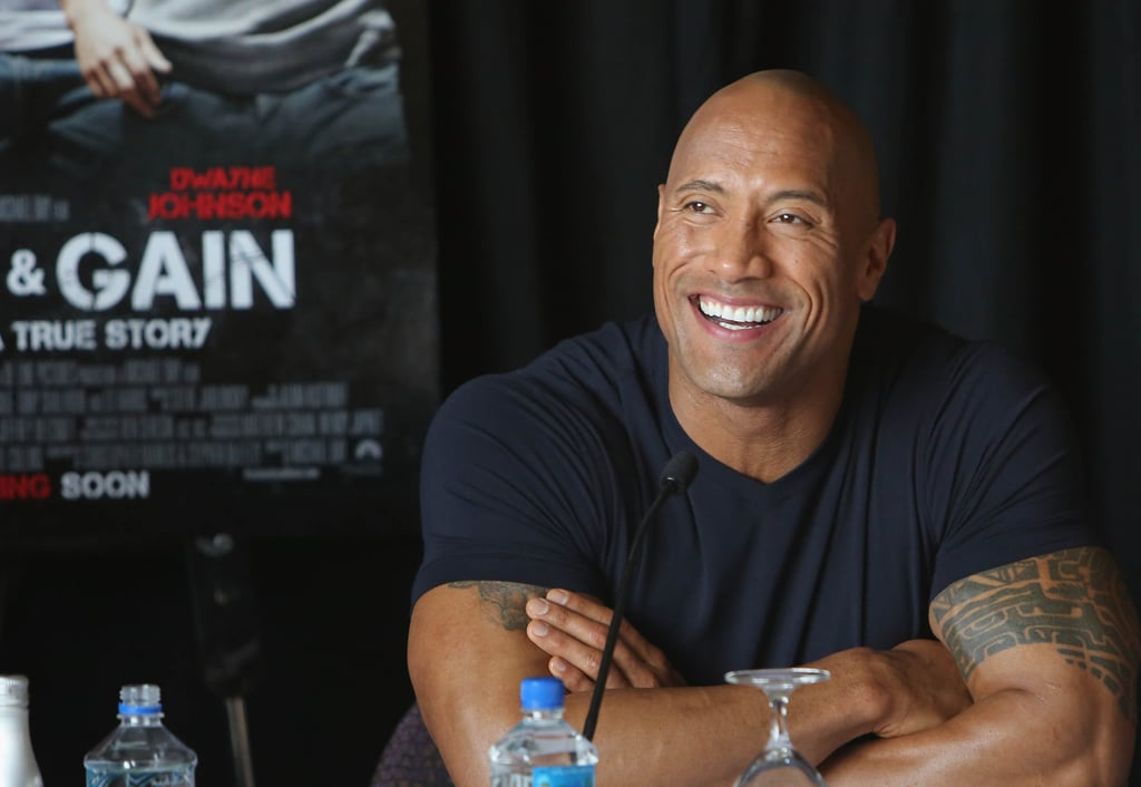 There's no denying that Dwayne Johnson is sexy no matter what he does. Whether he's flexing his muscles in the wrestling ring, walking the red carpet in a tailored suit, or flashing his signature smile, we simply can't get enough of The Rock. Sure, Dwayne is known for his incredibly chiseled body and movie-star good looks, but did you know he is also super funny and down to earth? On top of all that, he is a dedicated family man and pretty great boyfriend to longtime partner, Lauren Hashian. To celebrate the sexy renaissance man, we've rounded up every single time Dwayne looked so hot, he rocked our worlds (see what we did there?). Scroll through for 110 of his sexiest moments from over the years.