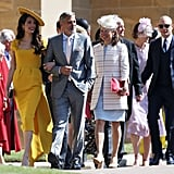 With Amal and George Clooney at Prince Harry and Meghan Markle's wedding in 2018.
