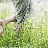Walking barefoot in the grass.