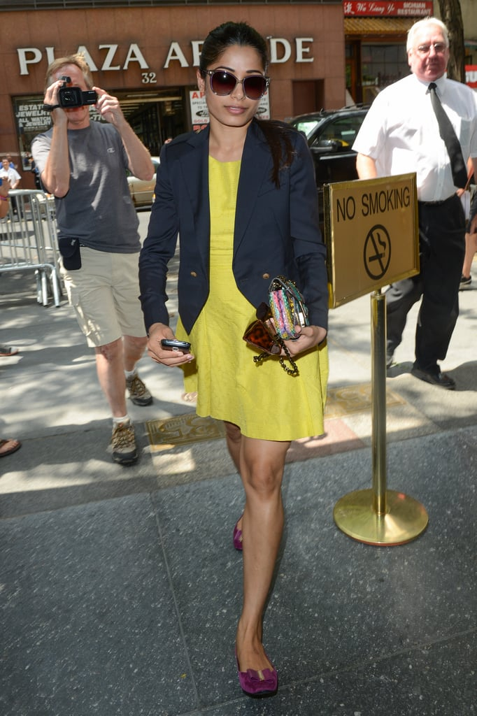 Freida arrived for the Today show taping in another Rachel Roy Resort '13 dress — the other was worn at an NYC screening. She paired fuchsia-hued Roger Vivier flats with her yellow sheath and navy blazer.