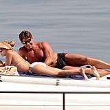 Scarlett Johansson got her tan on in a white bikini while floating around Sicily in July.
