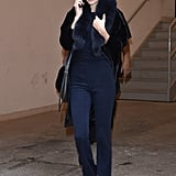 Afterward, She Bundled Up in a Navy Look and White Sneakers