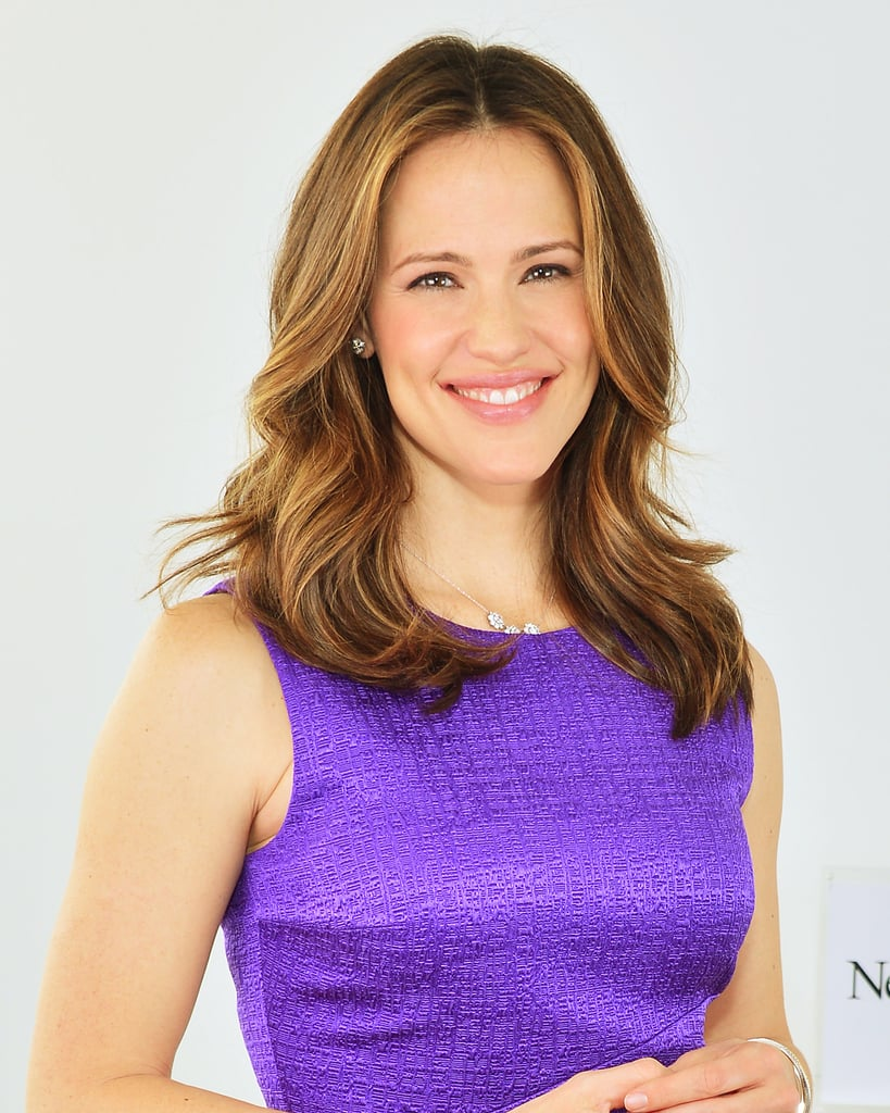 To get big, soft curls like Jennifer Garner, use a two-inch curling iron on large sections of hair (think: four to six thick sections total). Once the curls are set, brush them out to soften the look.