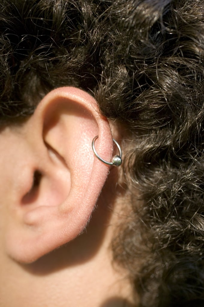 """What Is the Healing Time For Cartilage Piercings? The healing time for any piercing is widely dependent on the individual and the aftercare procedure followed. In general, cartilage piercings are harder to heal than lobe piercings. """"All cartilage piercings generally heal in about six months, in comparison to lobe piercings which take around six weeks,"""" said Schneider. """"Cartilage piercings tend to be more sensitive and tender than lobe piercings, requiring extra care during the healing process.""""  Anyone who has ever had both an ear lobe piercing and a cartilage piercing knows this struggle all too well. Lobe piercings can feel like its healing itself; meanwhile, cartilage piercings have a tendency to put up a fight. This is because of two things: a lack of blood flow to that area of the ear and how much the piercing is irritated.  """"The cartilage has an extremely limited blood supply so healing is slower and in contrast to the ear lobe,"""" said Schneider, citing it can take anywhere from three to six months to heal for some people, or as long as six to 12 months for others.  Additionally, irritation is more likely with cartilage piercings. """"For example, if it's on an area of the ear that led to constant irritation while you sleep or use earbuds, that will make the piercing harder to heal,"""" she said. """"Due to the long healing process, aftercare is crucial when piercing the cartilage."""""""