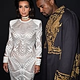 Kim wore a white gown with a choker while attending the Balmain show with Kanye during Paris Fashion Week in 2015.