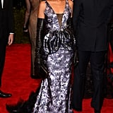 Kerry Washington's rendition of punk at the 2013 Met Gala in NYC included a purple metallic floral gown by Vera Wang, complete with badass black leather opera gloves and Christian Louboutin pumps.