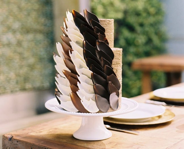 This simple two-tiered cake is given an edgy touch with carefully placed chocolate petals — stunning!