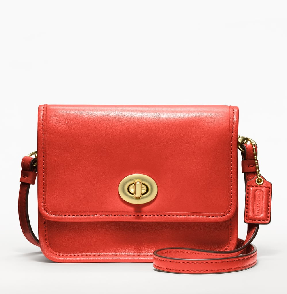 """This diminutive crossbody Coach bag is simply irresistible. The red hue and classic turnlock detail are the perfect mix of modern-meets-classic. Also, the lightweight mini silhouette is perfect for my upcoming Coachella trip."" — Chi Diem Chau, associate editor  Coach Classics Leather Mini Crossbody ($118)"