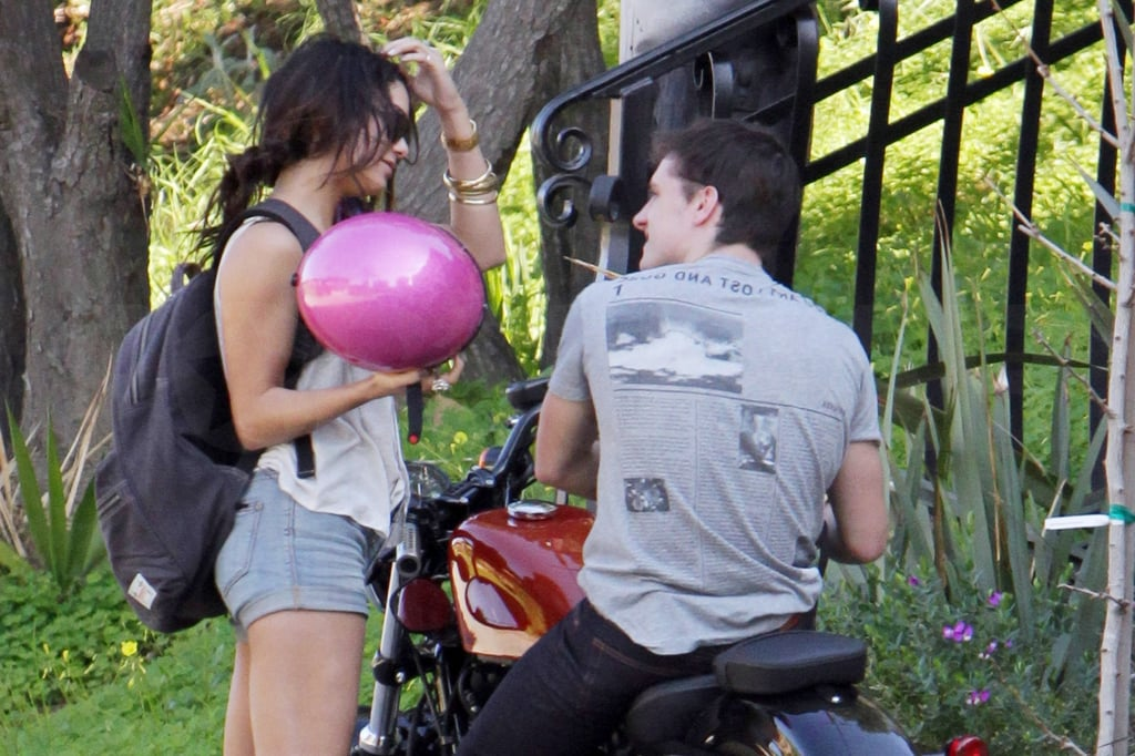 Vanessa Hudgens arrived back at her LA home yesterday afternoon on the back of a motorcycle driven by her Journey 2: The Mysterious Island costar Josh Hutcherson. The duo, who grew close while filming last Summer, were rumored to be romantically involved after they were spotted cozying up at an afterparty for her film Beastly. Despite Vanessa's moving on with her love life in the wake of her split from Zac Efron, she's still dealing with some issues from her past. A new set of nude photos have popped up of the former Disney starlet, and she's apparently quite angry about their release.
