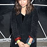 Zoe Kravitz layered up in a plaid shirt and a corduroy blazer at the GenArt party.