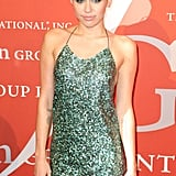 Miley Cyrus covered up at NYC's Fashion Group International Night of Stars on Tuesday.