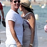 Pregnant Lauren Silverman stayed close to Simon Cowell during their beach day in the South of France.