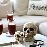 These blood-red cocktails placed near a simple skull help create an elegant atmosphere for a Halloween party. With a few vampire fangs placed around the house, this party definitely will not suck.       Related:                                                                                                           9 Spooky Halloween Cocktails Featuring the Most Frightening Spirit: Tequila