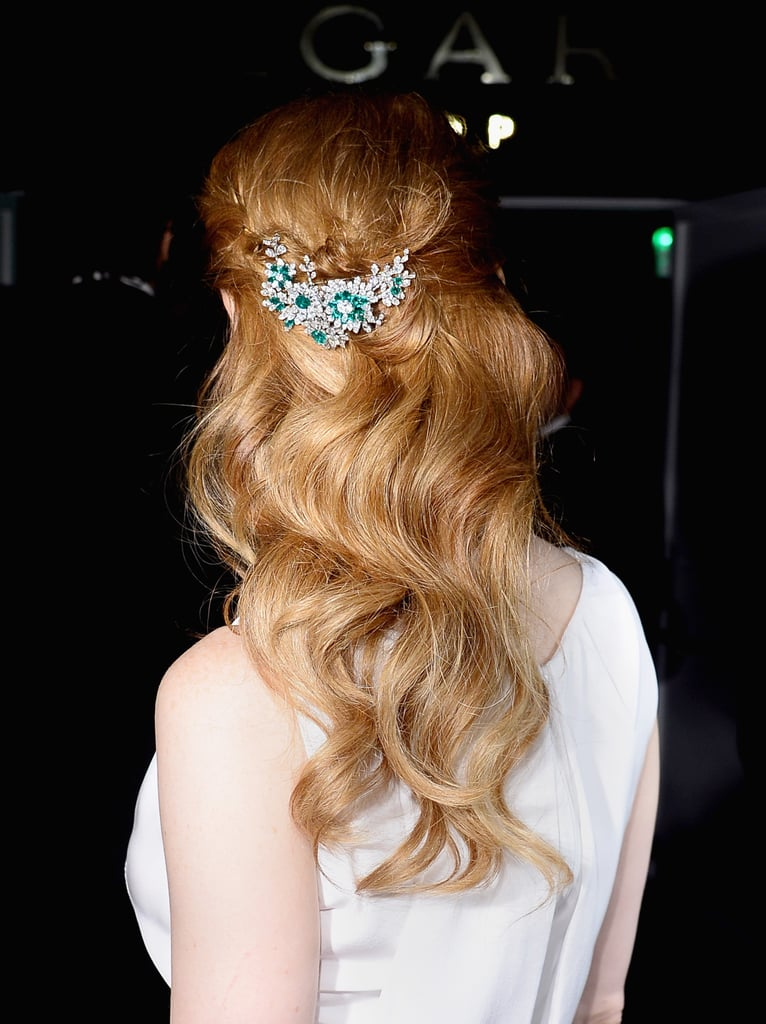 Jessica Chastain adorned her signature strawberry-blond locks with a glittering broach at the Cannes Film Festival. The cascading waves adorned with sparkle make for a prime bridal style.