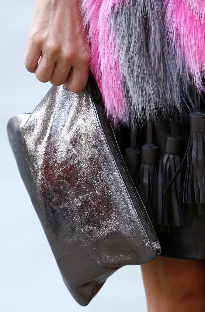 A metallic zippered clutch is the perfect accompaniment to a leather skirt and fur topper.