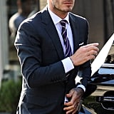 David Beckham wore sunglasses and a suit.
