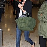 Rosie Huntington-Whiteley perfected travel style with an enviable Céline luggage tote in tow.
