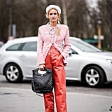 Wear Thick Leather Pants and Dark Boots With Your Sugar Pink Jacket