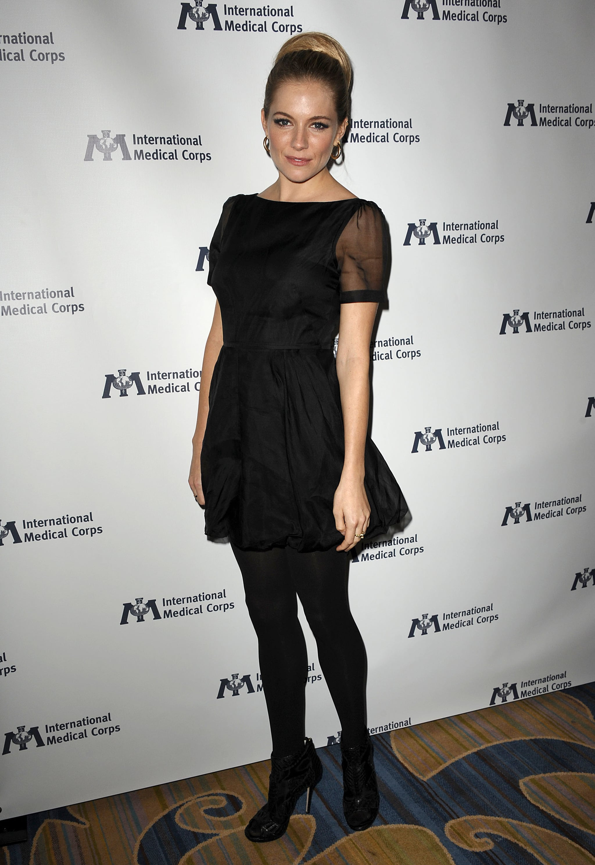 Sienna wore a sheer-sleeved LBD with tights and ankle booties in 2011.